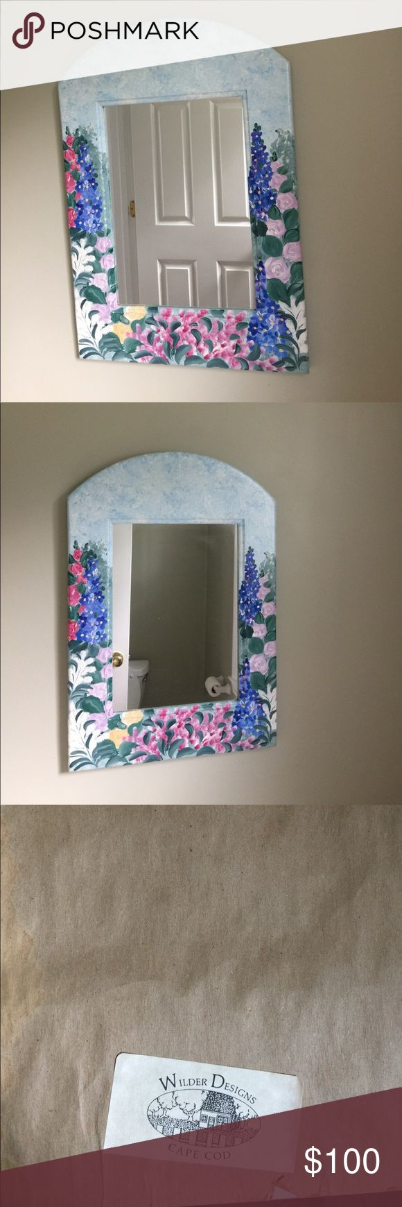 "Hand Painted Cape Code Wall Mirror Beautiful hand painted flowers on a light blue wall mirror.  Possible flowers: Roses, lupine, Dblfinien. From Wilder Designs of Cape Code. Dimensions 15 1/2"" x 22"" Other"