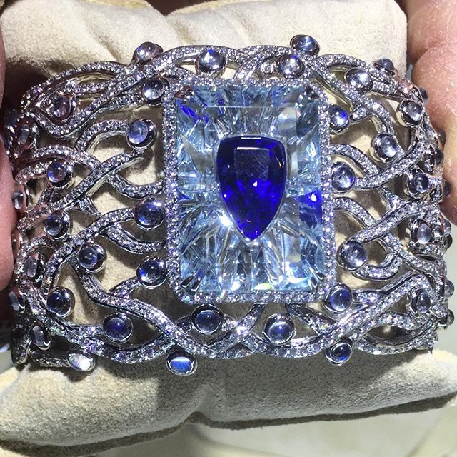 . The Sentience bracelet is a showstopper. A 33+ carat Tanzanite sits security in carved aquamarine, surrounded by moonstones and diamonds.
