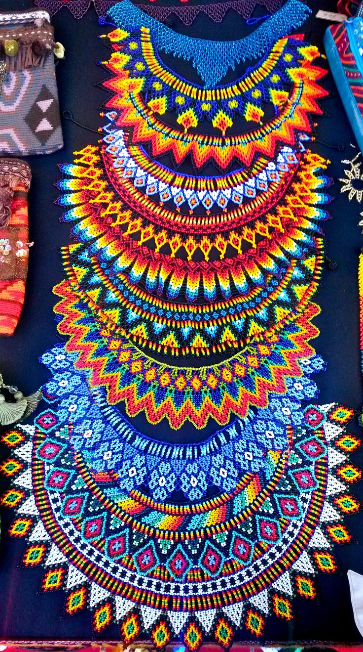 Necklaces made of traditional stones by the Embera tribe of Colombia. The Colors are a beautiful Statement. #Fashion #craft #colombia #travelandmakeadifference