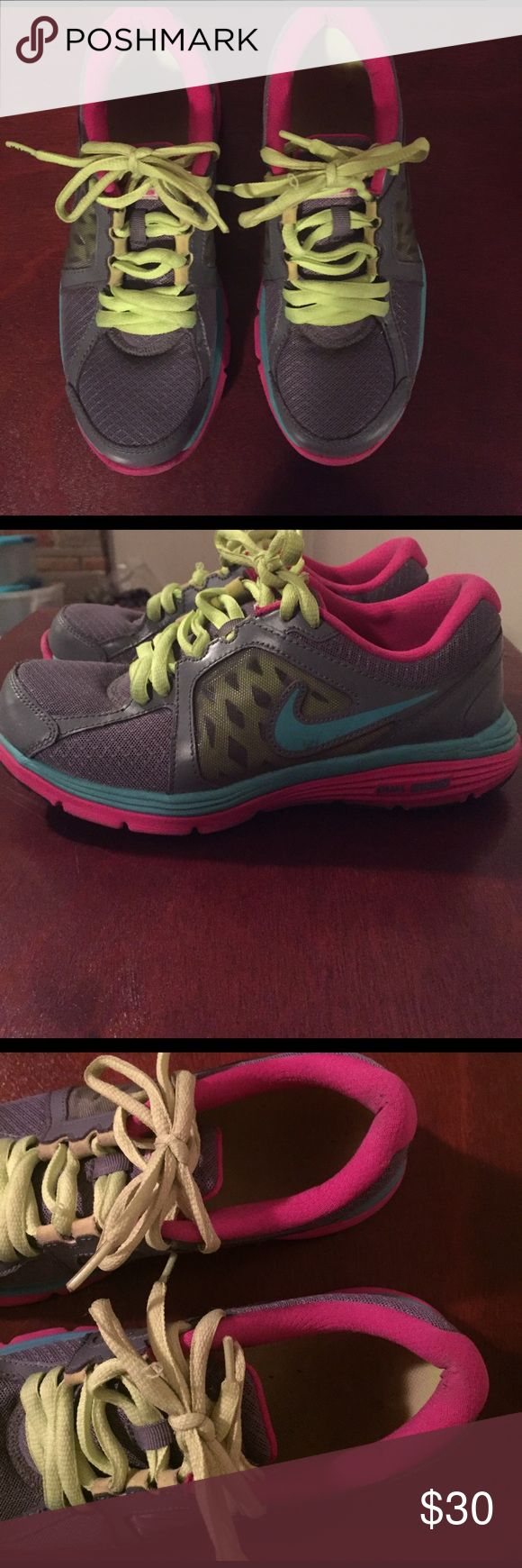 Nike shoes size 8.5 Nike shoes size 8.5. Gray pink and aqua. Do not have original shoe laces. In great condition. Smoke and pet friendly home. Nike Shoes Sneakers