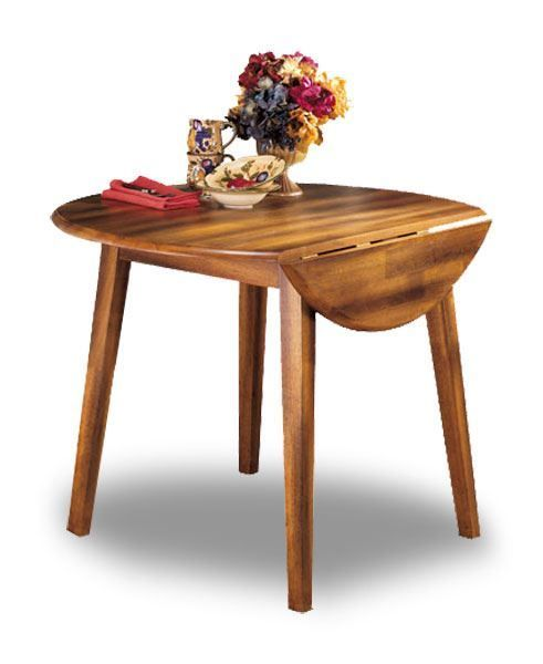 Berringer Country Drop Leaf Round Table by Ashley Furniture is now in stock  at American Furniture