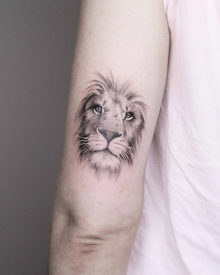 Black and grey dotwork lion head tattoo on arm by @minnietattooart