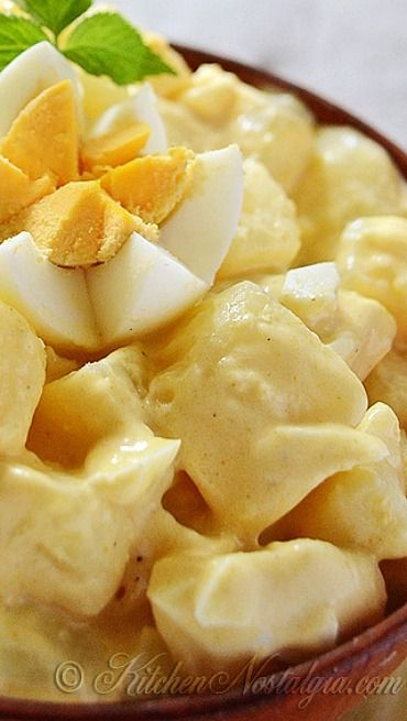 Amish Potato Salad ~ This good old-fashioned deli salad combines cooked potatoes with creamy yellow sweet and sour dressing enriched with hard boiled eggs, sour cream and mustard.