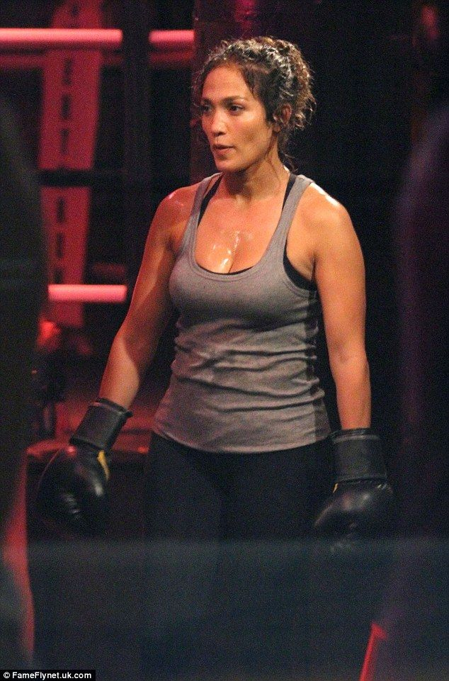 Ready to rumble: Jennifer Lopez donned a pair of boxing gloves and raised a sweat while shooting scenes for her TV show Shades of Blue on Friday in Manhattan