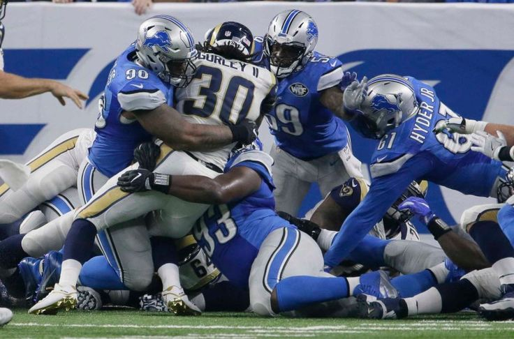 Rams vs. Lions:     October 16, 2016  -  31-28, Lions  -    Los Angeles Rams running back Todd Gurley (30) is stopped by the Detroit Lions defense at the goal line on fourth down during the first half of an NFL football game, Sunday, Oct. 16, 2016, in Detroit.