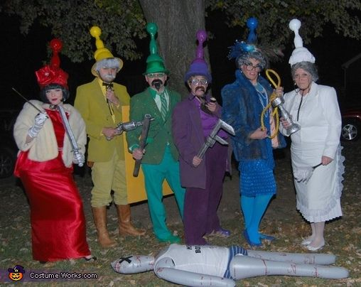 CLUE Group Costume. The game pieces and Mr. Boddy are what sells this group costume for me! XD