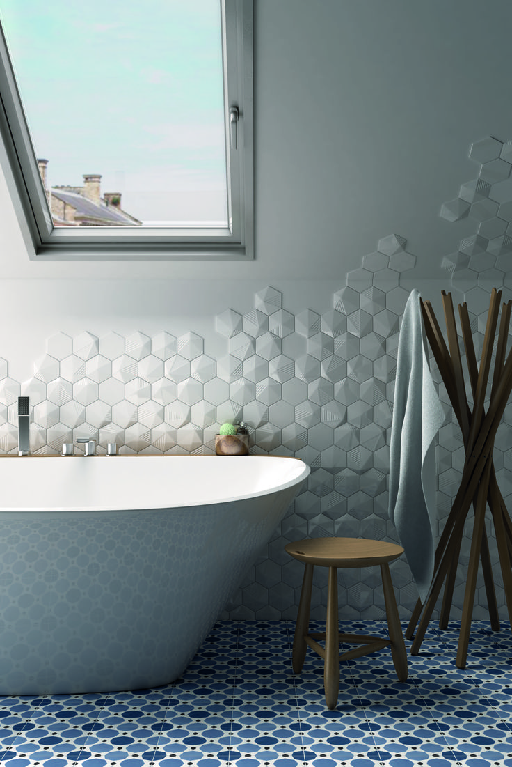 Scale is a collection of hexagonal white body wall tiles offered in Hex (2D) and Umbrella (3D) versions and a wide range of shades for endless color combination possibilities. The three dimensional angular Umbrella tile will instill perspective and light into your project. Modern bathroom.