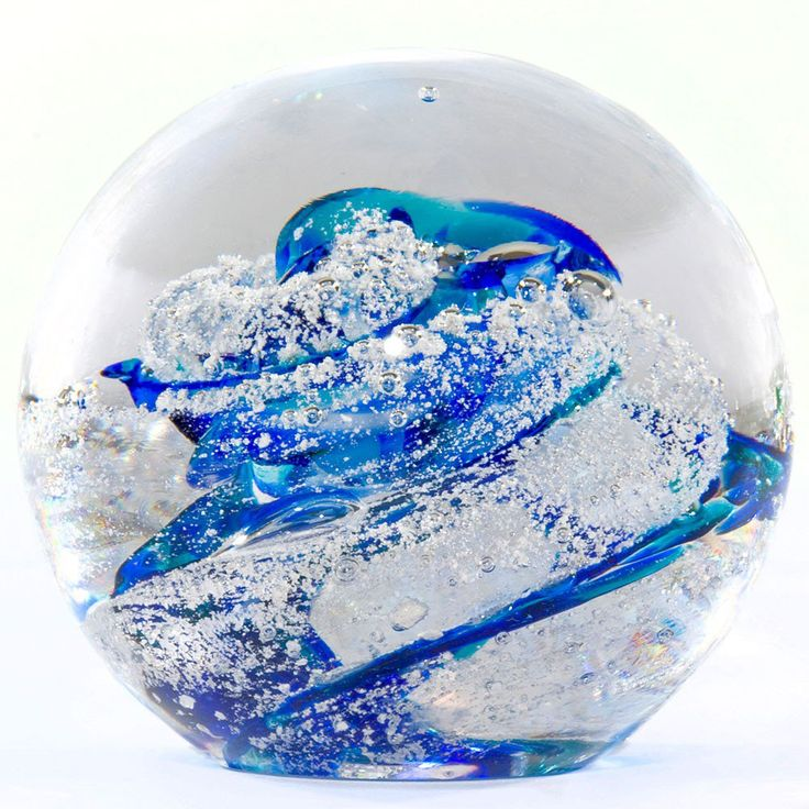 Glass Blown Ashes Memorial - This cremation urn idea is a unique way to display your loved one's ashes. Create a truly one-of-a-kind work of art memorializing your loved one by incorporating a small amount of cremains into blown glass. There are 4 colors available. View piece here.