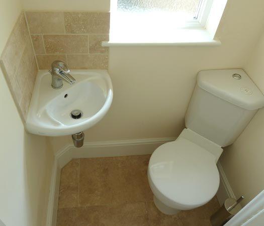 Compact bathroom- corner sink and corner toilet