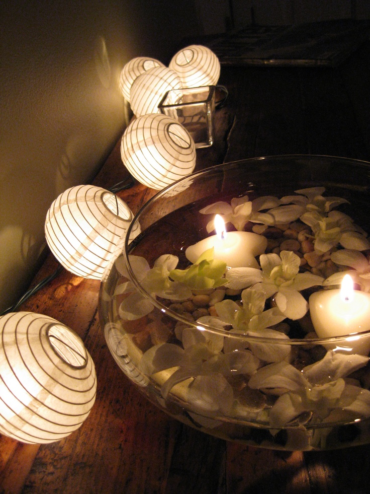 Floating candles, orchids & mini japanese lanters on a rustic wooden table for cocktail hour. Design & Coordination: Wild Orchid Weddings & Events. http://wildorchidweddingscr.com