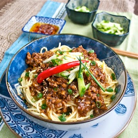Minced pork in black bean sauce over noodles.