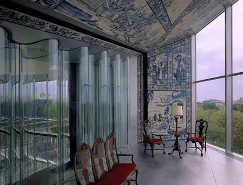 Casa Da Musica, Porto, Portugal, 2005 - OMA.  Get this!  That's a curved *double glazed* glass wall!