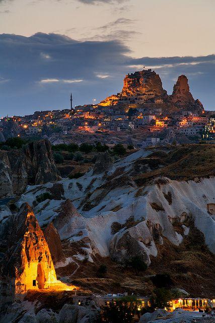 Goreme glow under spotlights during summer twilight, Cappadocia, Turkey   by John and Tina Raid via Flickr