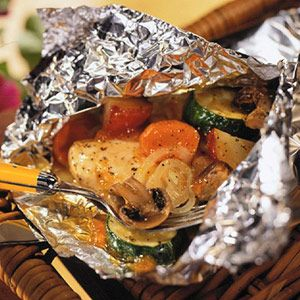 Grill this dinner in foil packets. The chicken is served with potatoes, carrots, zucchini, mushrooms, and onions, making this dish a complete meal.