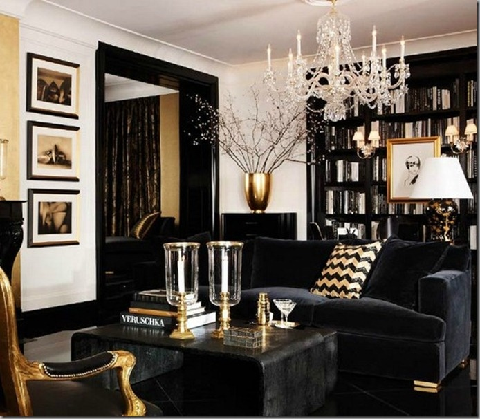 High gloss black trim and cabinetry, ebony floors, white walls with touches of gold - so clubby cool