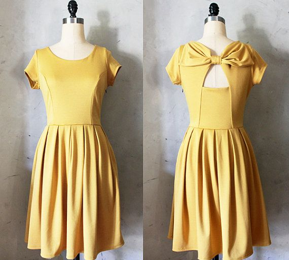 HOLLY GOLIGHTLY in MUSTARD  Muted yellow dress by FleetCollection, $68.00 I want to try and make it!