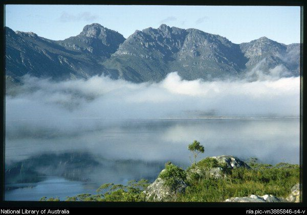 Lake Pedder from the Coronets to the Frankland Range in an early morning mist, Tasmania - Olegas Truchanas