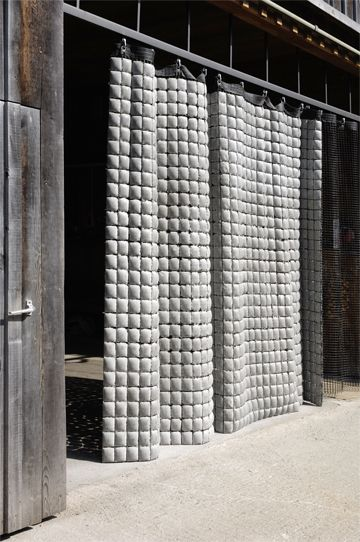 this is pretty cool- Concrete curtain .The betonvorhang consists of only two elements: concrete cushions are attached to one another through a solid fabric and form a texture that is reminiscent of a quilt.