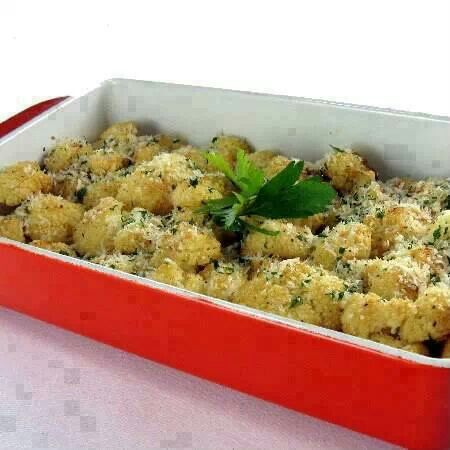 Oven Roasted Cauliflower Ingredients: 1 medium head cauliflower (about 2-1/4 pounds), trimmed and cut into florets 3 large cloves garlic, thinly sliced 1/4 cup olive oil 2 tablespoons lemon juice 1/2 teaspoon salt 1/4 teaspoon black pepper 2 tablespoons grated Parmesan cheese.