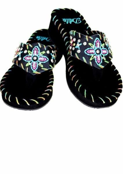 These lovely flops are embellished cowgirl embroidered style while sizes and fit true. If a 1/2 size go up. About 1 1/2 inch heel.