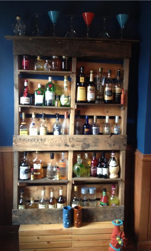Rustic bar made from salvaged warehouse pallets.  Do a smaller version to hang above the bar for liquor display.