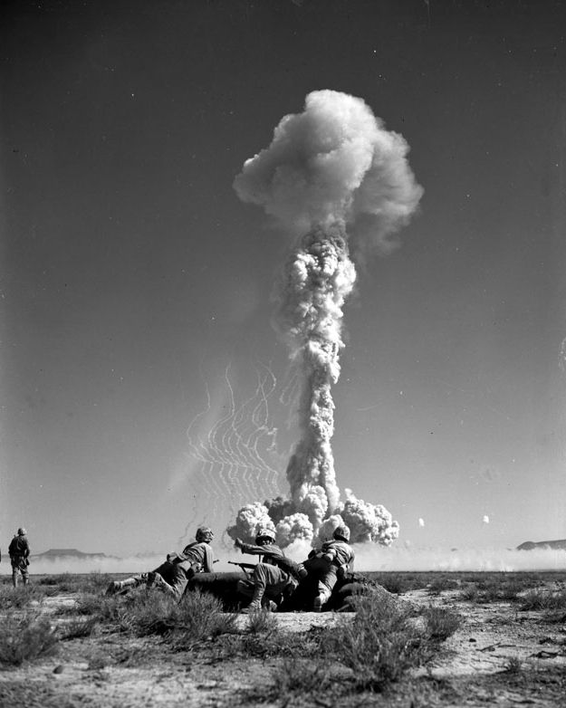 U.S. Marines prepare to charge seconds after a nuclear test at the Nevada Test Site, 1952. The blast was part of Operation Tumbler-Snapper.