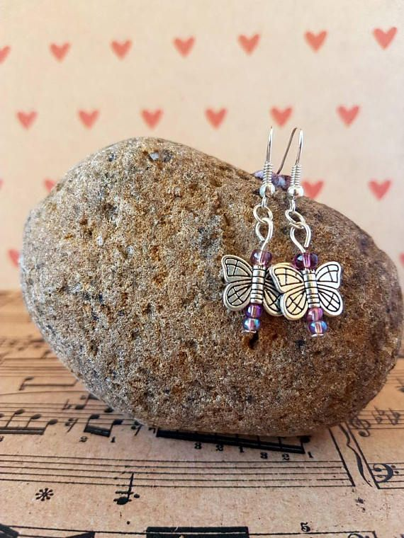 Check out this item in my Etsy shop https://www.etsy.com/au/listing/526400460/butterfly-earrings-purple-and-silver