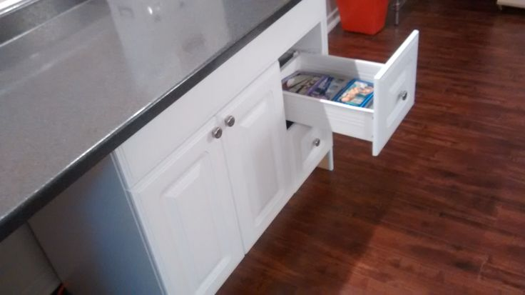 These are standard, hardware store kitchen cupboards with custom cut countertop on top.