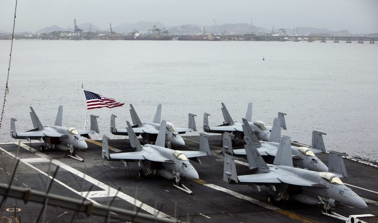 Fighter jets sit on the deck of aircraft carrier USS Carl Vinson, at the Guanabara bay in Rio de Janeiro, Feb. 26, 2010. (AP/Silvia Izquierdo)
