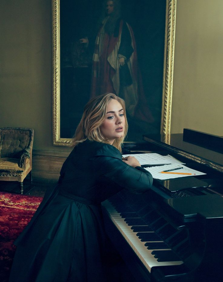 Adele is already perfect but this picture is gorgeous. I love the cool color tones and the arrangement of the piano and painting with her.