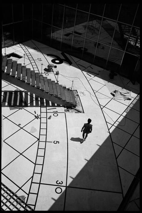 """Martine Franck. FRANCE. Paris. The """"Grande Arche de la Défense"""" (commercial and financial district). 1989"""