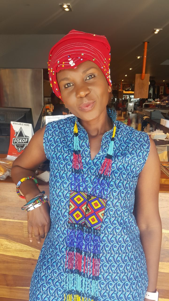 South African celebrating heritage day with Xhosa qiya (head wrap),African print and beads.