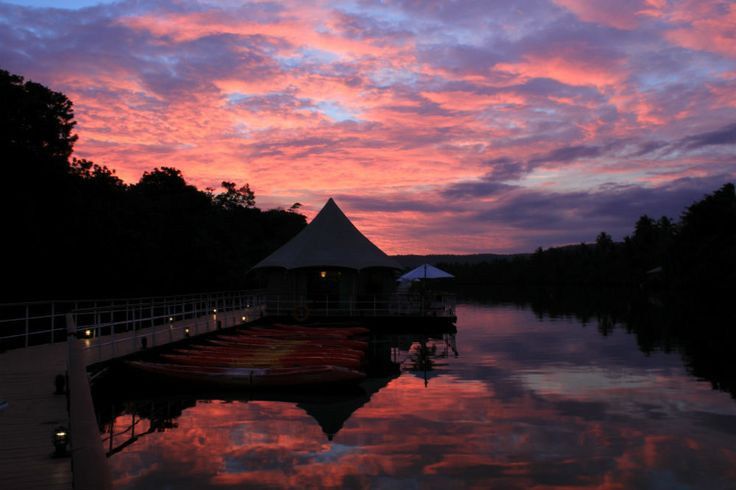 Floating in a river of tranquility, night beckons over 4 River Floating Lodge, Koh Kong, Cambodia