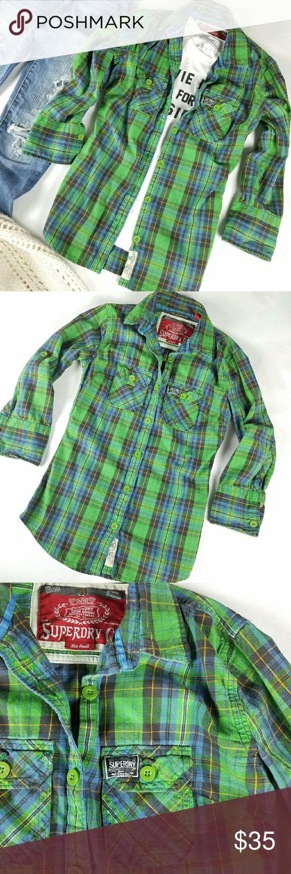 Super Dry Plaid Button Down Top Vibrant plaid button down top. Thick material. Double chest pockets. Sleeve can be rolled and secured with buttons. This has a flattering, slim fit. True to size. 100% Cotton.   Excellent gently preloved condition with no rips, holes or stains.   No holds, trades or off-posh transactions. Superdry Tops Button Down Shirts