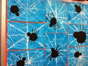 Interesting spider webs. Here is how it was done. First they drew the spider web using white oil pastels on white paper and then painted the whole page with blue water color. The wash made the web highly visible. Next, they traced/cut circles for the spider's head and body. For the final touch, they used a cardboard edge dipped in black paint for the legs.