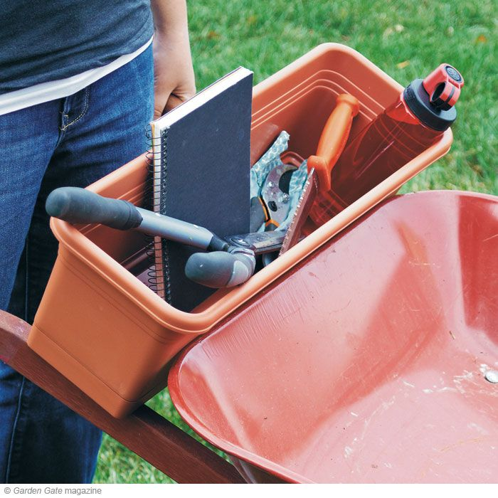 Wheelbarrow organizer! | Garden Gate eNotes.  This is a plastic window box type planter.  What a great idea.