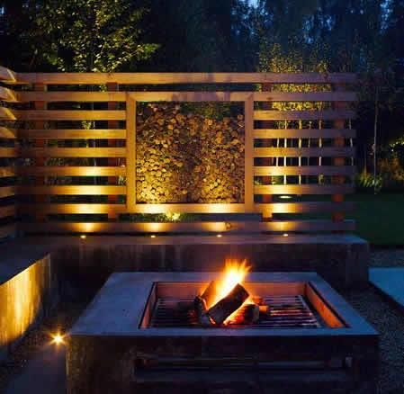 Berkeley house in Tetbury firepit and uplit screen feature wall installed by Johnstone Landscapes