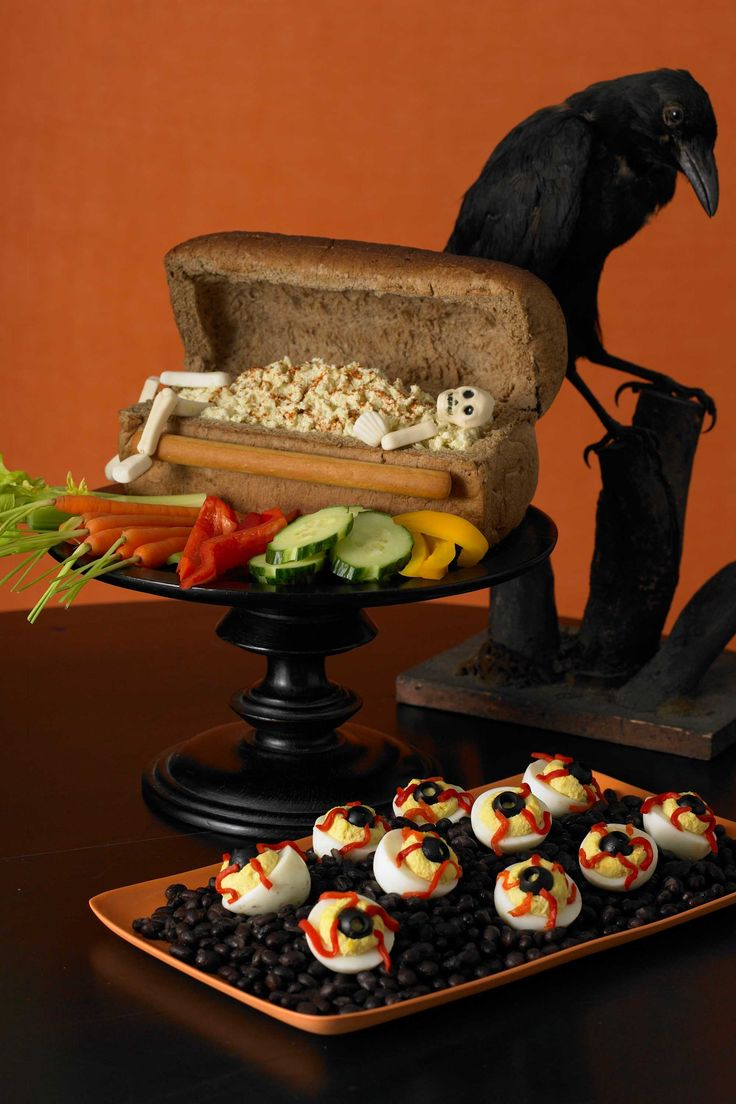 Bloodshot Deviled Eggs and that cute little bread loaf skeleton coffin with pasta in the background