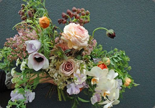 Notice the huge Japanese ranunculus in both bouquets!