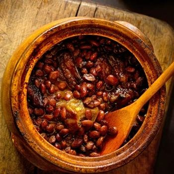 3 cups dried pinto beans  3 cups fresh apple cider  8 ounces salt pork, thinly sliced  2 small yellow onions, peeled and left whole  6 tablespoons molasses, preferably sorghum molasses  1 tablespoon dry mustard  2 teaspoons salt