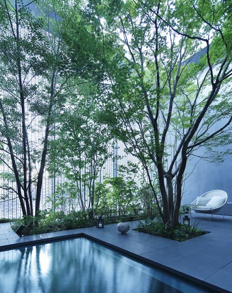 A Tree Filled Courtyard Is Behind A Shimmering Glass Brick Facade At The Optical  Glass House In Hiroshima By Hiroshi Nakamura U0026 NAP.