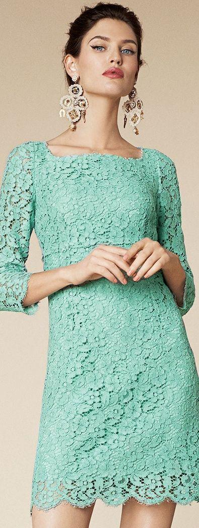 Mint green lace Dolce & Gabbana dress with gold chandelier earrings