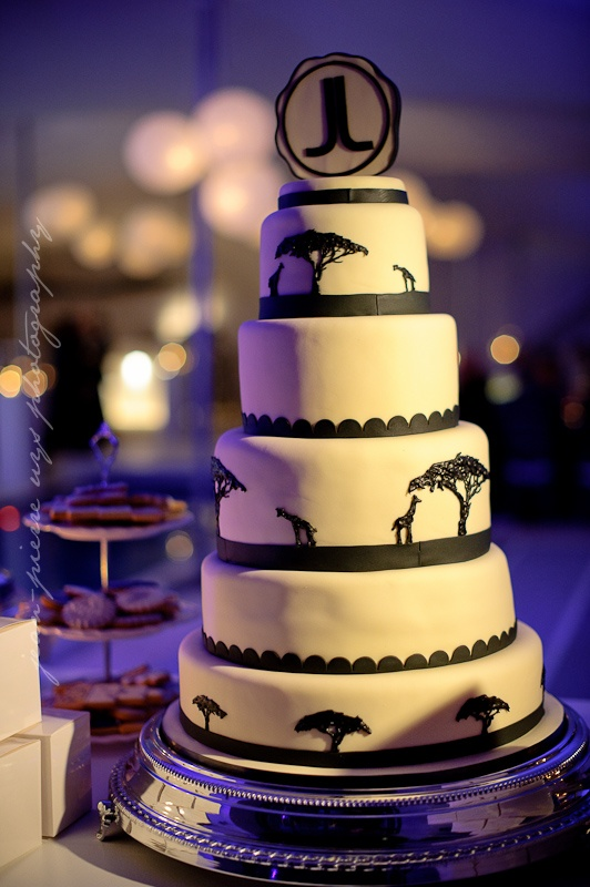 www.weddingconcepts.co.za  African icing and the couples initals on this unique 5-tiers cake.