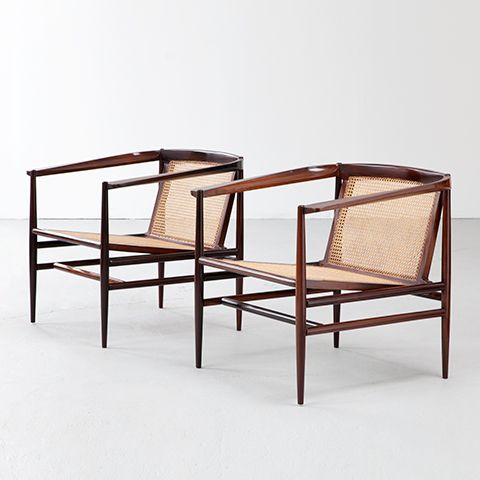 Joaquim Tenreiro, Brazil, 1950's Pair of lounge chairs in jacaranda with cane seat and back.