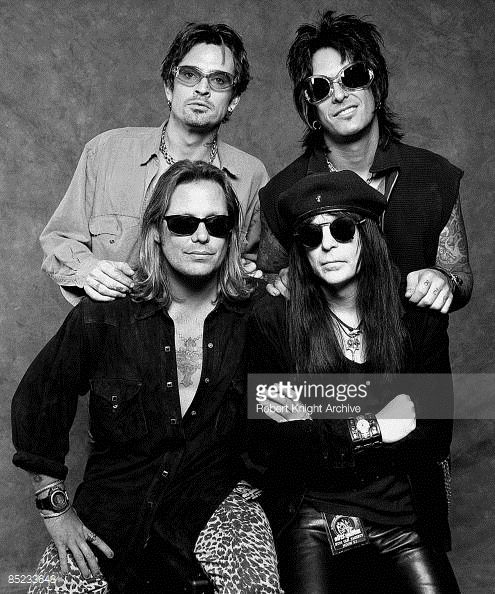 Tommy Lee, Nikki Sixx; (front): Vince Neil, Mick Mars - posed, studio, group shot
