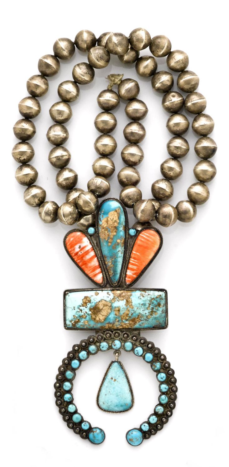 Navajo necklace, with strand of silver beads suspending an elaborate naja incorporating turquoise and spiny oyster bezels.