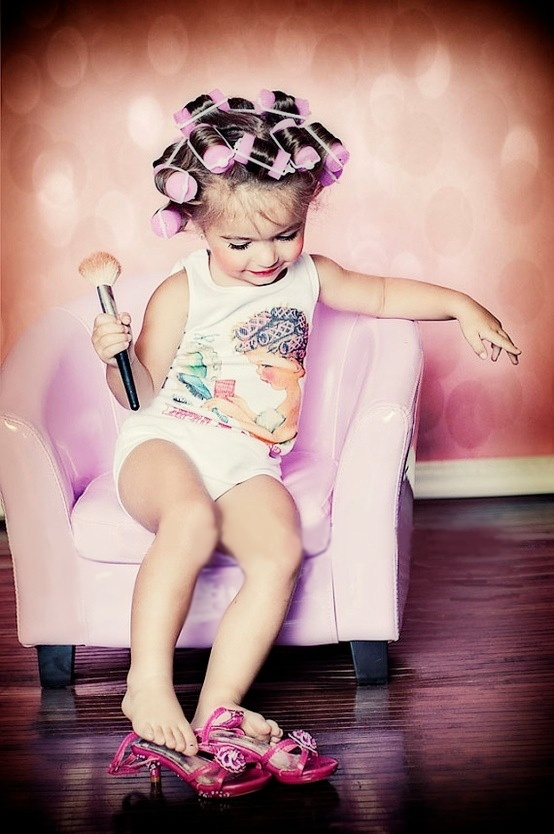 little blond girl in pink curlers