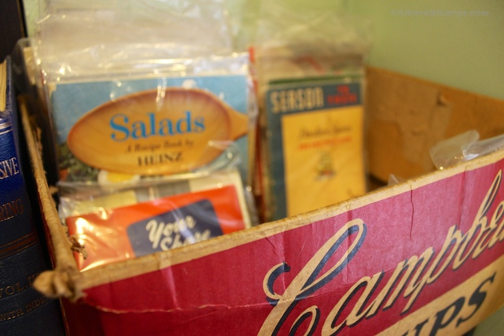 Recipe booklets for sale at The Monkey's Paw in Toronto, displayed in a vintage Campbell's Soup box.