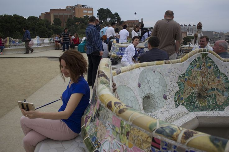 A woman testing out her selfie stick at Park Guell - Barcelona, Spain #spain #pictures #colorful #parkguell