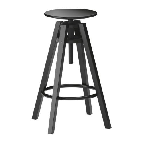 DALFRED stool with adjustable seat and footrest for added comfort and style at the bar.